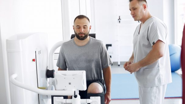 Doctor with a patient in physiotherapy clinic